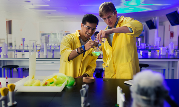 Two ANU College Science students doing experimenting in their campus lab.